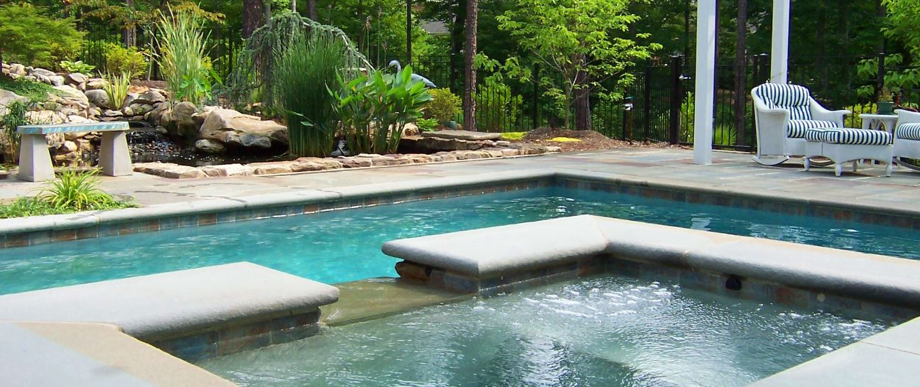 raised spa and waterfall with kio pond by landvision studio of haymarket virginia